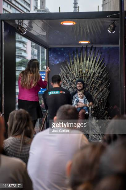 sitting on the game of thrones iron throne in são paulo - game of thrones iron throne imagens e fotografias de stock