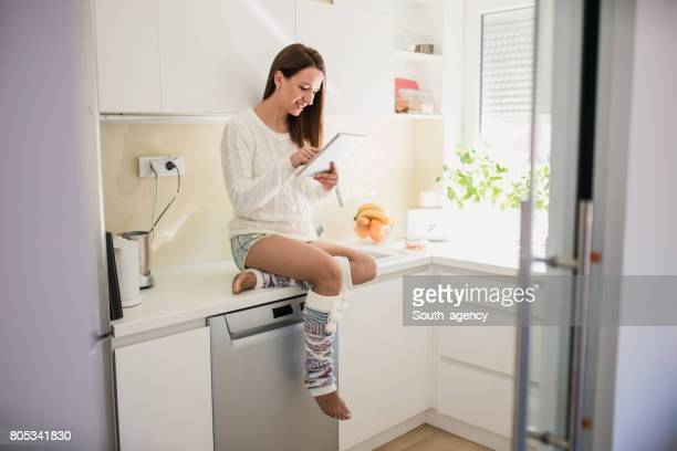 sitting on the kitchen counter - south_agency stock pictures, royalty-free photos & images