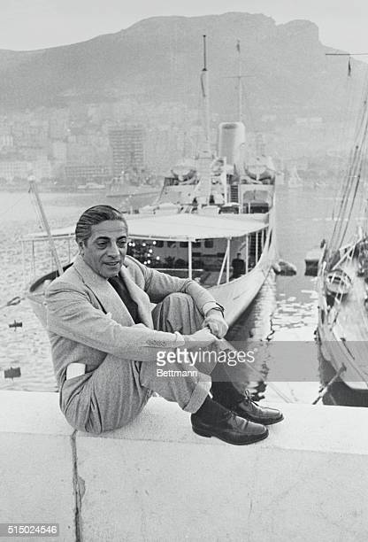 Sitting on the Quay wall in front of his converted $2000 destroyer yacht Christina is Greek shipping magnate Aristotle Onassis who gives his views...