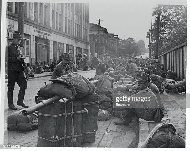 Sitting on Their Hands Tokyo Japan Parked on a Tokyo street these Japanese soldiers sit amid their belongings awaiting demobilization They seem to be...