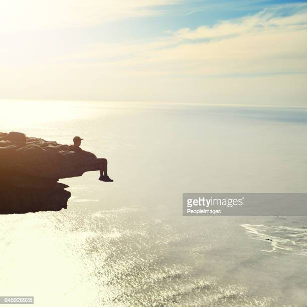 sitting on top of the world - rock overhang stock photos and pictures