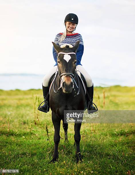sitting pretty in the saddle - headwear stock pictures, royalty-free photos & images