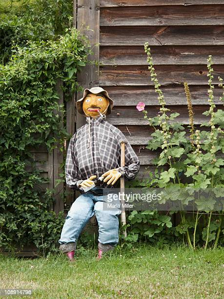 sitting scarecrow - scarecrow agricultural equipment stock photos and pictures