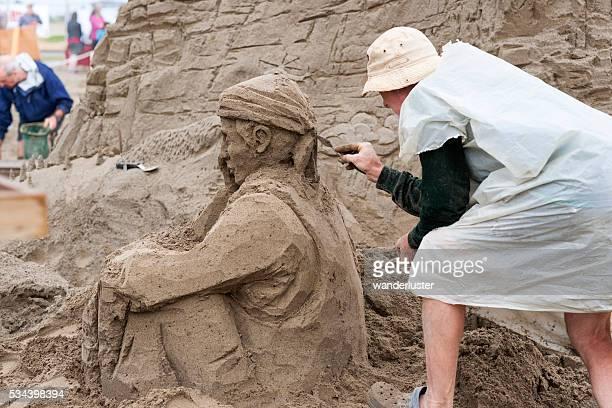 Sitting soldier sand sculpture