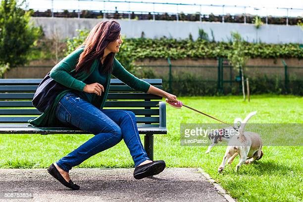 Sitting with dog at the park