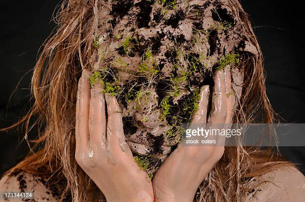 sitting with earth on her face