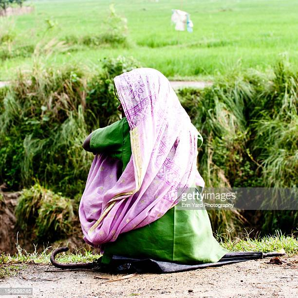 sitting woman - lumbini nepal stock pictures, royalty-free photos & images