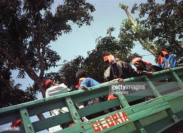 Situation in Atambua, Indonesia on September 12, 1999 - Truck of militia from East Timor drive around the streets of Atambura taken by this hidden...