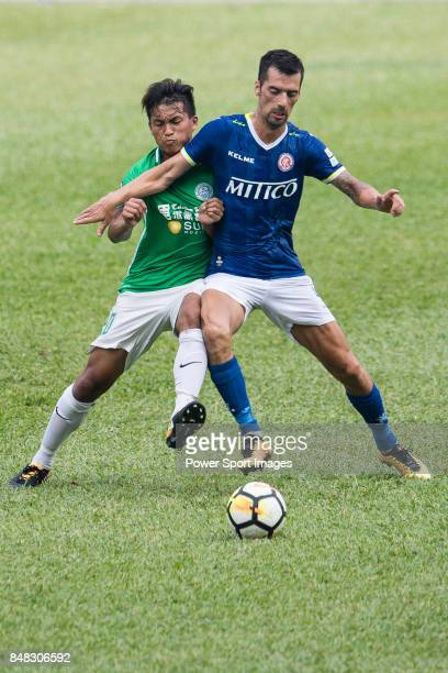 Siu Wai Chiu of Wofoo Tai Po fights for the ball with Marko Krasic of Rangers during the week three Premier League match between BC Rangers and Wofoo...