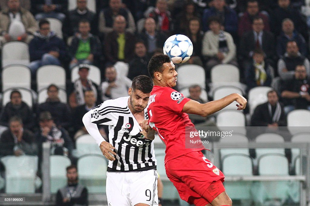 Siviglia defender Timothee Kolodziejczak (5) and Juventus forward Alvaro Morata (9) head the ball during the Uefa Champions League group stage football match n2 JUVENTUS - SEVILLA on 30/09/15 at the Juventus Stadium in Turin, Italy.