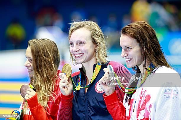 Sivler medalist Jazz Carlin of Great Britain gold medalist Katie Ledecky of United States and bronze medalist Boglarka Kapas of Hungary celebrate...