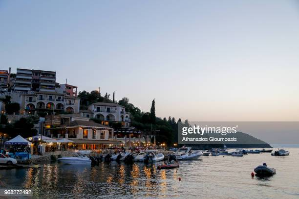 Sivota village on the sunset on August 02 2015 in Syvota Greece Syvota town is developed resort and owing largely to the numerous pristine beaches...