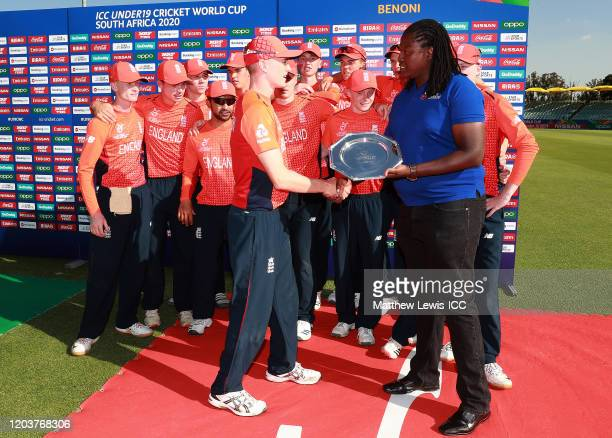 Sivuyile Mqingwana Tournament Director presents George Balderson of England with the Plate after the ICC U19 Cricket World Cup Plate Final match...