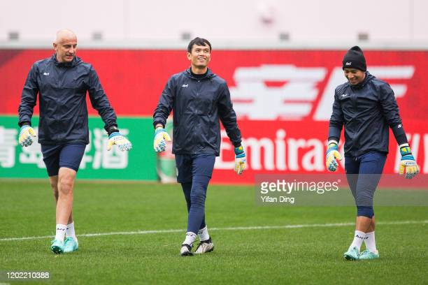 Siwarak Tedsungnoen and Yotsapon Teangdar of Buriram United warms up during a training session prior to the AFC Champions League Preliminary Round...