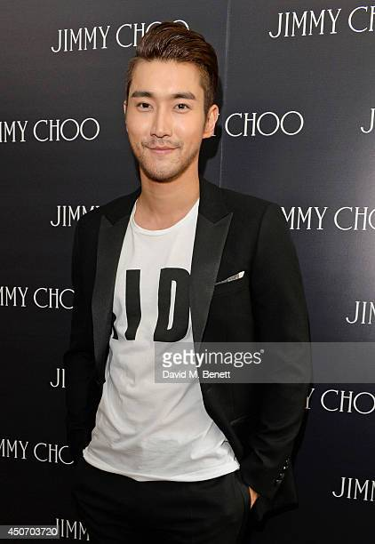 Siwon Choi attends the Jimmy Choo Men's Show Spring Summer 2015 during London Collections Men on June 16 2014 in London England