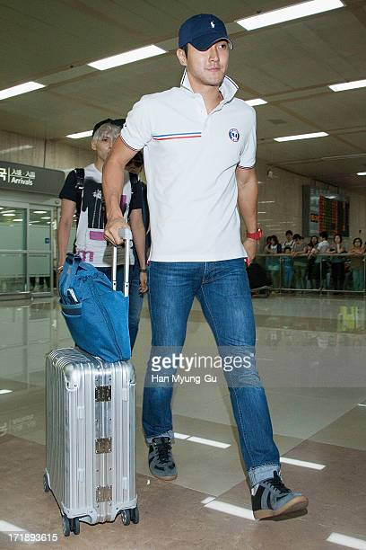 Siwon of South Korean boy band Super Junior is seen upon arrival at Gimpo Airport on June 29 2013 in Seoul South Korea
