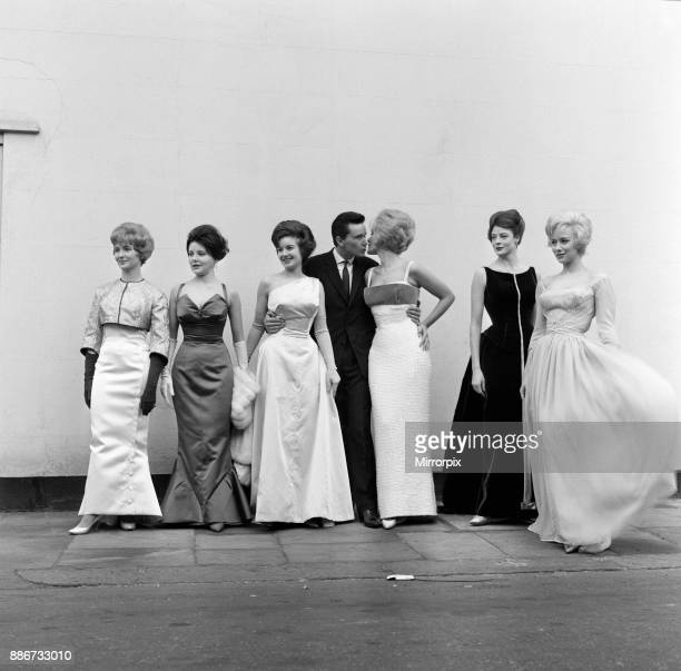 Six actresses line up at Cornwall Gardens, Kensington for a fitting and a photo call. They are wearing the gowns which have been designed by Alan...