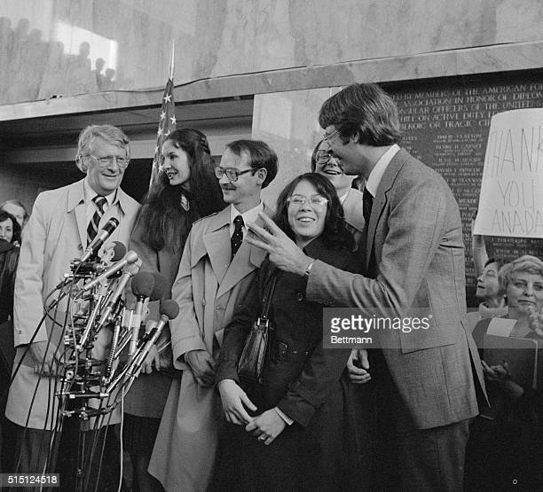 Six Americans receive a warm welcome at a press conference in Washington DC after being rescued in Iran by the Canadian embassy They are Robert...