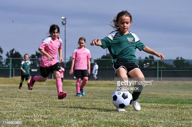 Six and sevenyearold Rainbow Unicorn team players attempt to score a goal during a West Valley Soccer League girls soccer match on May 5 2019 in Los...
