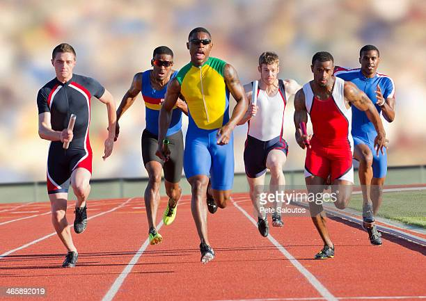 Six athletes running on race track