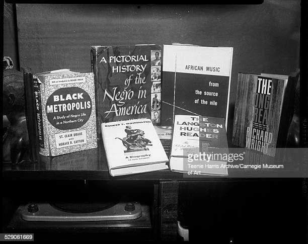 Six books displayed on shelf including titles 'Black Metropolis' 'A Pictorial History of the Negro in America' 'Booker T Washington a Biography'...