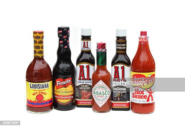 Six bottles of various condiments and sauces