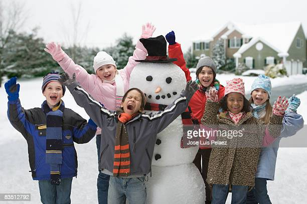 six children around a snowman - west new york new jersey stock pictures, royalty-free photos & images