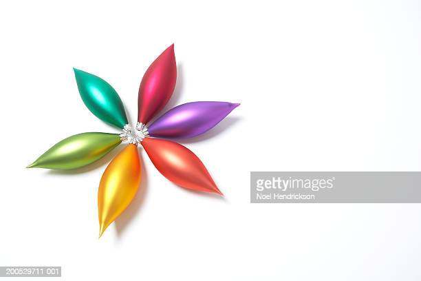 Six Christmas ornaments arranged in shape of flower or star