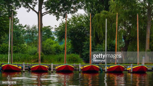 Six colorful sailing boats in a row