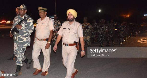 Six companies of CRPF take out a flag march ahead of final hearing of Dera Sacha Sauda Chief Sant Gurmeeat Ram Rahim Singh in the alleged rape case...