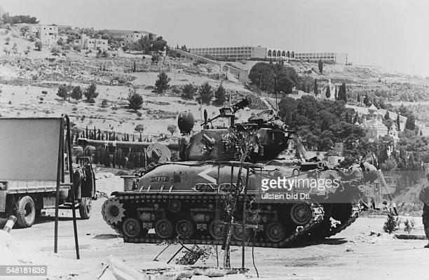 Six Day War Israeli tank formation encircling the old town of Jerusalem from the North A tank at the foot of Mount Scopus with the Hebrew University