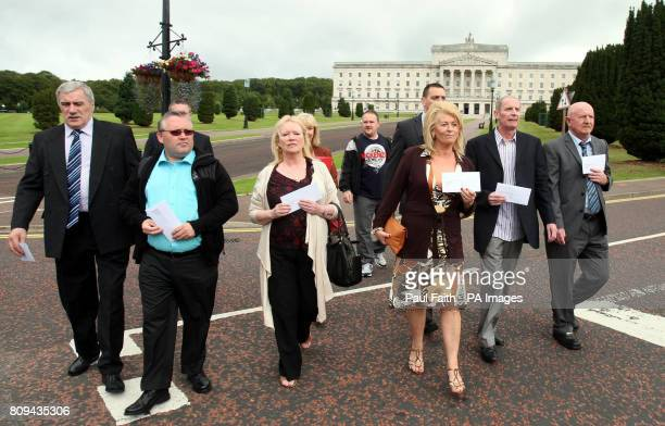 Six Former Internees Joseph Curley Thomas Doyle Evelyn Gilroy Geraldine McCann Kevin Donnelly and Brian Ward prepare to hand a letter into Stormont...