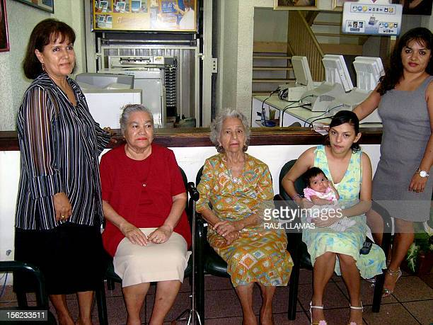 Six generations of Mexican women pose during an interview with AFP on August 30 2008 in Nuevo Laredo northern Mexico Elizabeth Castro 51 Julia Ramos...