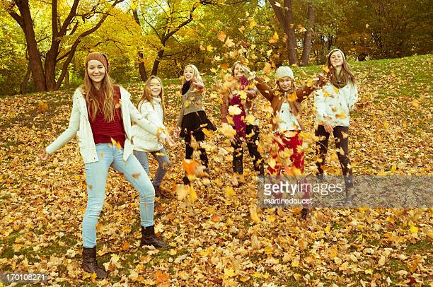 "six girls playing with autumn leaves. - ""martine doucet"" or martinedoucet bildbanksfoton och bilder"