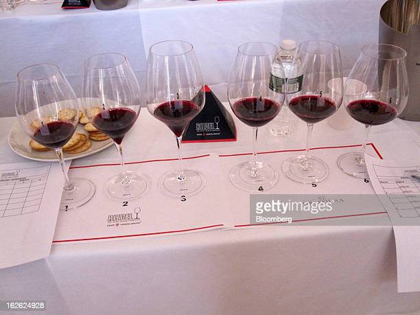 Six glasses filled with Graffigna's 2010 Centenario Reserve malbec stand on a table during a taste workshop held at the Argentine consulate in New...