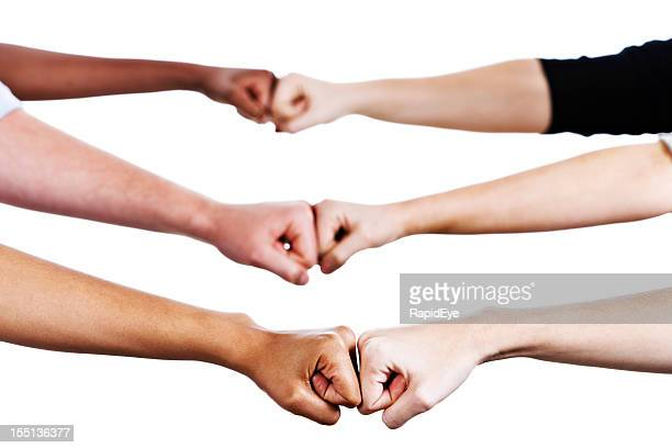 six hands greet by bumping fists - fist bump stock pictures, royalty-free photos & images