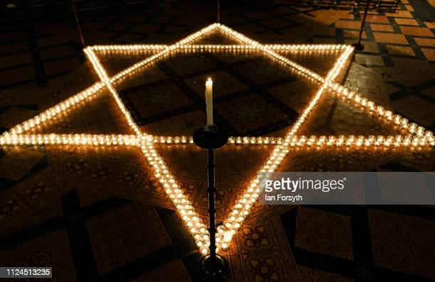 Six hundred candles in the form of the Star of David are set out during an event to commemorate Holocaust Memorial Day in Chapter House at York...