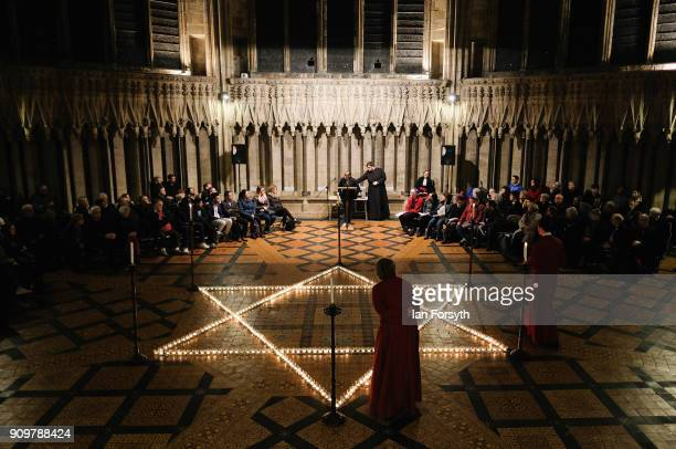 Six hundred candles set out on the floor in the form of the Star of David are lit during a special event to commemorate Holocaust Memorial Day at...