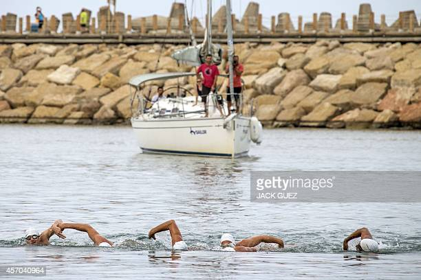 Six Israeli swimmers arrive at the Marina in the Israeli coastal city of Herzliya after swimming in turns 400 kms from the Mediterranean island of...