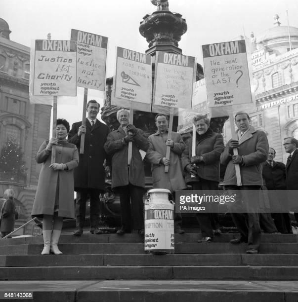 Six labour MP's interested in oversea's aid pictured with placards at the base of the Eros statue in Piccadilly Circus London when they joined Young...