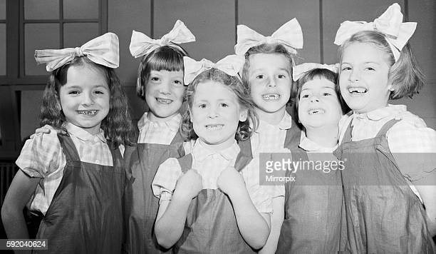 Six little dancing girls smile to camera and reveal that they have all lost their front teeth. Left to right Ann Fleetwood, Wendy Hill, Sylia Perks,...