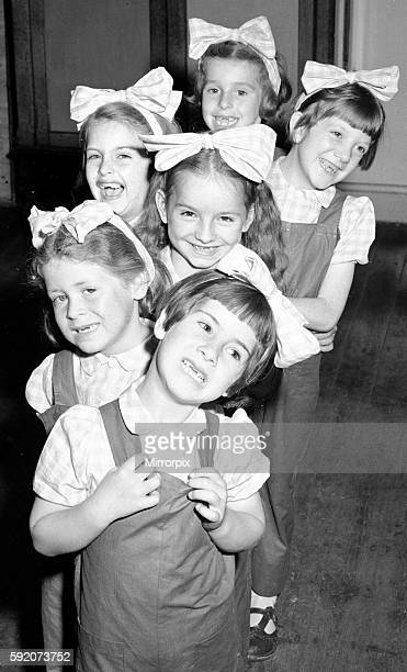 Six little dancing girls smile to camera and reveal that they have all lost their front teeth.Front to Back, Colette Buckeridge, Sylia Perks, Ann...