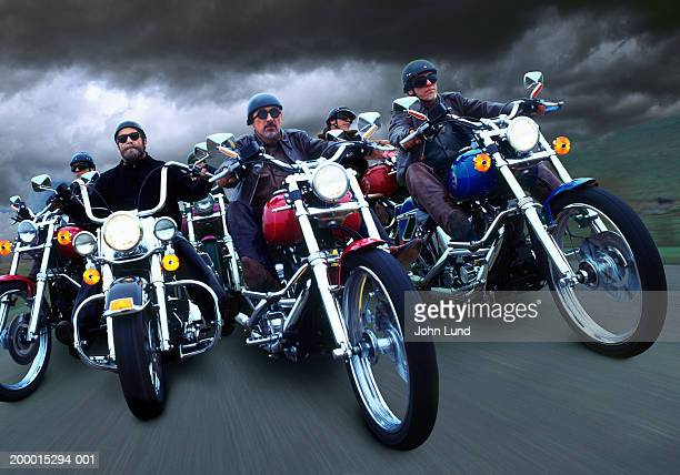 Six men riding motorcycles on road (Digital Composite)