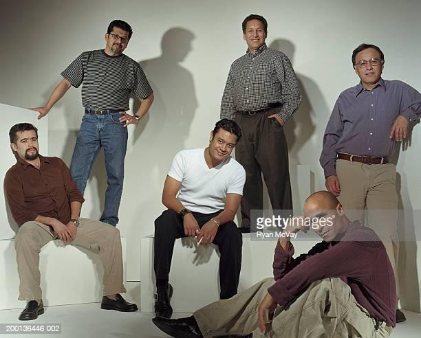 Six men smiling, portrait