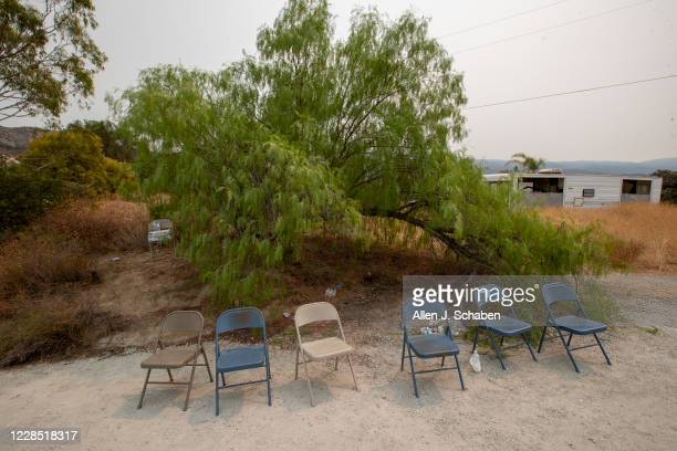 Six metal chairs lined in a row and one not that far back at the location where seven people were shot to death over Labor Day weekend at an illegal...