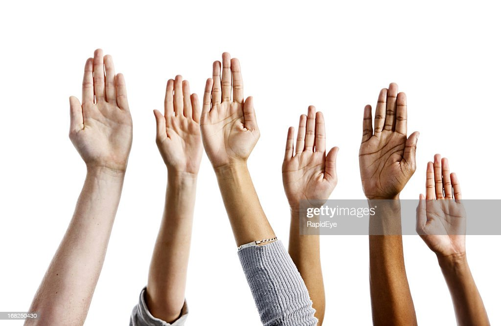 Six mixed hands raised against white background : Stock Photo