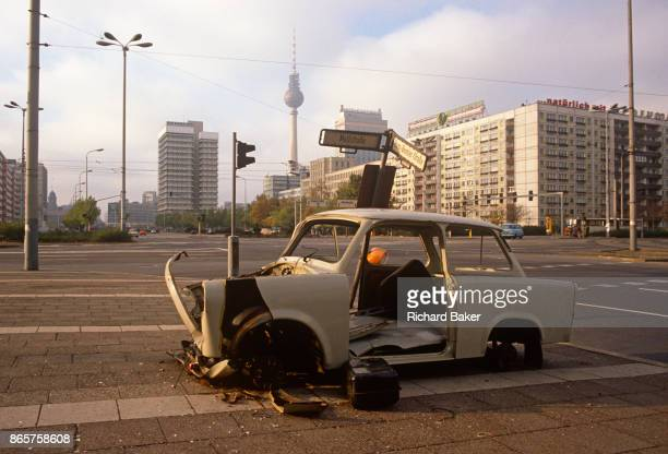 Six months after the fall of the Berlin Wall a Trabant car sits wrecked on the corner of Mollstrasse and HansBeimlerStrasse in east Berlin on 1st...