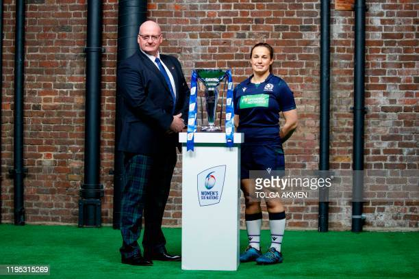 Six nations women's international rugby coach and captain, Scotland's Philip Doyle and Scotland's Rachel Malcolm, pose with the trophy during the 6...