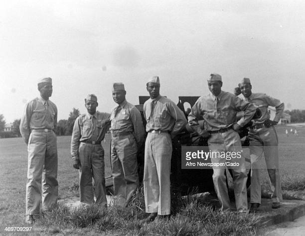 Six Negro Officer Candidates of the Chemical Warfare School at Edgewood Arsenal are grouped around the retreat gun Maryland 1950
