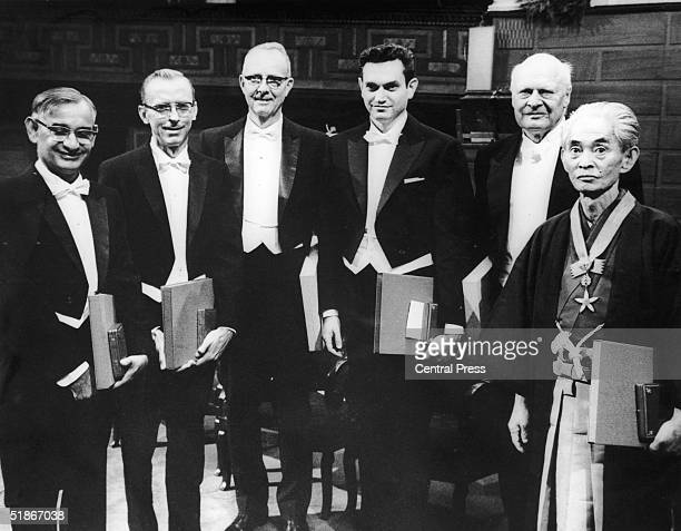Six Nobel Prize winners pose for the camera after the award ceremony in Stockholm 12th December 1968 Left to right Har Gobind Khorana Robert W Holley...